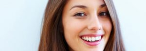 Close-up of lady smiling about the health benefits of Chiropractic help